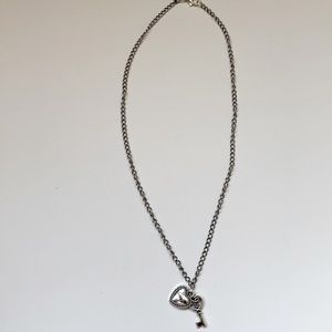 Jewelry - a necklace with a key and a heart charm